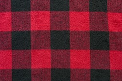 Black and Red Fabric in a Cage. Plaid material. Clothes background