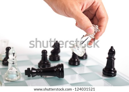 Black and transparent glass chess pieces, on a see through chessboard. Checkmate.