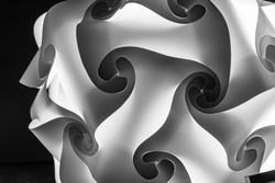 Black and white abstract photos of light puzzle shapes