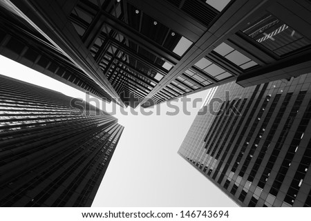 Black and white abstract upward view of downtown skyscrapers.