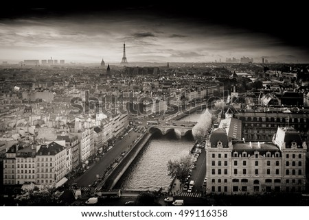 Black and White Aerial Photo of Paris, France from Notre-Dame Cathedral with Eiffel Tower in the distance. Spectacular sunset with warm light in autumn.