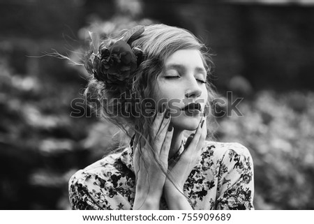Stock Photo Black and white art monochrome photography. A woman with curly hair in a floral dress