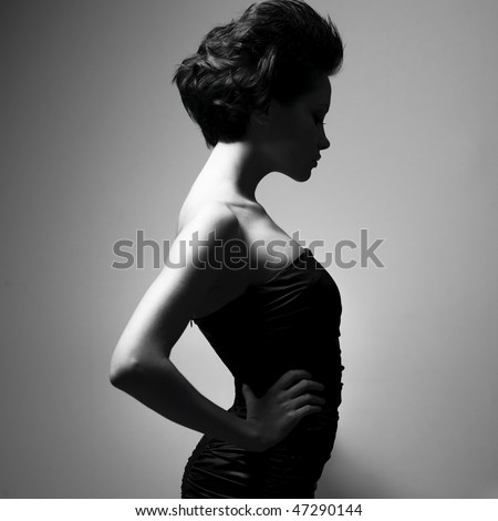 Black and white art photo. Elegant lady with stylish short hairstyle.