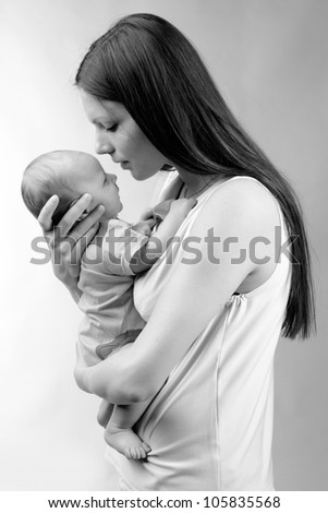Black and White Art photo of beautiful mother holding baby boy