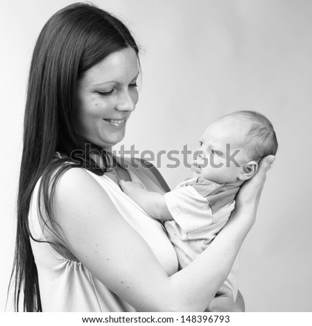 Black and White Art photo of beautiful mother holding baby boy/tender mother love