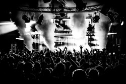 Black and White Audience Crowd Silhouette Dancing to DJ Pete Tong at Cream Nightclub Party. Nightlife Lazer Show Hands In Air With Smoke Cannon Blast