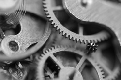 Black and white background with metal cogwheels inside clockwork. Conceptual photo for your successful business design. Macro.
