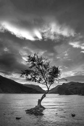 Black and white Beautiful landscape image of Llyn Padarn at sunrise in Snowfonia National Park
