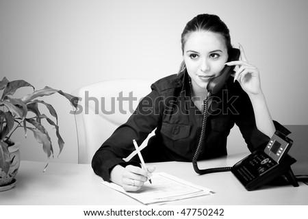 black and white beautiful secretary talking on the phone stock photo