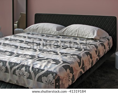 black and white bedroom. king size bed with black and white sheets.