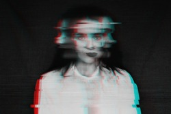 black and white blurred abstract portrait of a girl with mental disorders and schizophrenia with a glitch effect of virtual reality