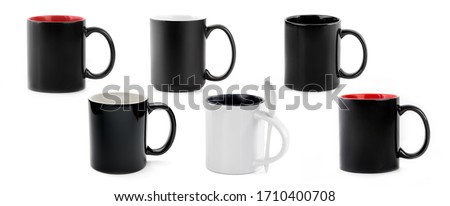 Black and white ceramic cups isolated on white background Сток-фото ©