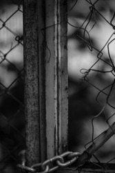 black and white chained gate