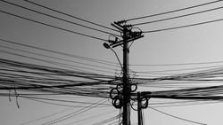Black and white Chaos of Power lines, Telephone and electricity wires in Thailand.