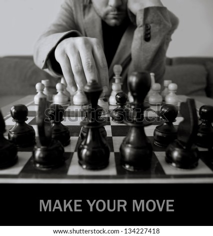 black and white chess concept with man make move- space for sample text