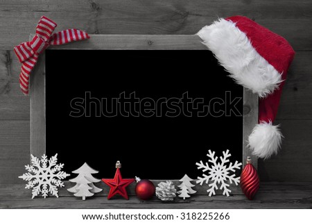Black And White Christmas Chalkboard With Copy Space, Free Text. Red Christmas Decoration, Loop, Santa Hat, Christmas Ball, Christmas Tree, Snowflake. Wooden Background. Vintage Rustic Style.