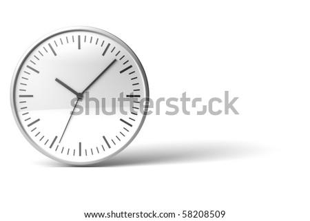 black and white chrome clock on white desk