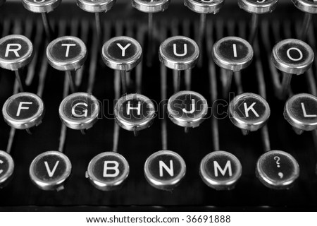 Black and white classy shot of an old typewriter's keys. Dirty and dusty and worn through lots of use since the 1900-1920s period when they were made.