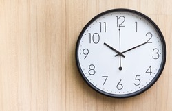 black and white clock on wooden wall in late morning, free copy space
