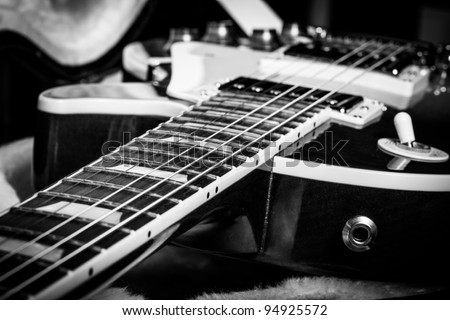 Black and White Close Up of an Electric Guitar Laying Inside a Guitar Case