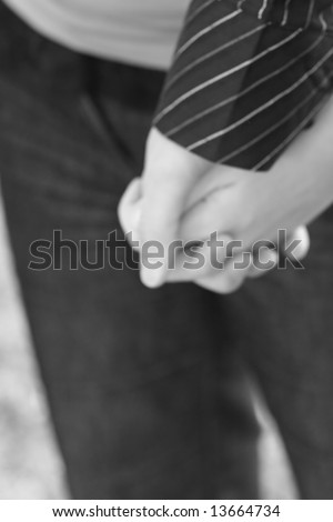 stock photo : black and white close up of couple holding hands