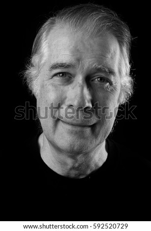 black and white  close up portrait headshot of a senior man in his 50's. handsome distinguished looking man.