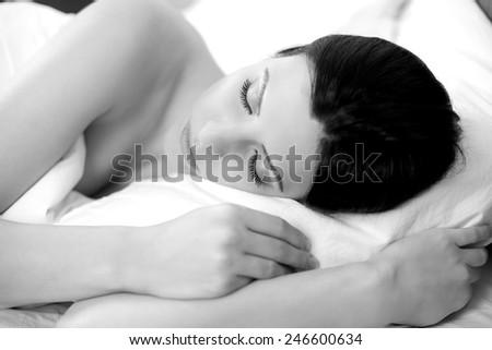 black and white closeup of beautiful woman having good sleep
