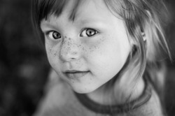 black and white closeup portrait of beautiful girl with big expressive eyes