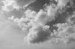 black and white clouds and sky. Dramatic sunlight of blue sky and clouds in Black and White. Black and white clouds texture on the dark sky background abstract.