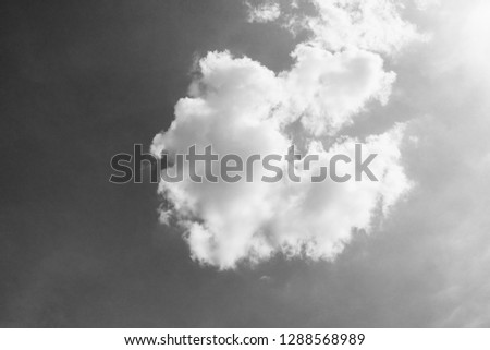 black and white clouds and sky. Dramatic sunlight of blue sky and clouds in Black and White. Black and white clouds texture on the dark sky background abstract. #1288568989