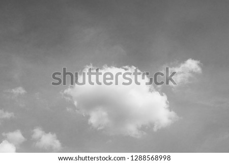 black and white clouds and sky. Dramatic sunlight of blue sky and clouds in Black and White. Black and white clouds texture on the dark sky background abstract. #1288568998