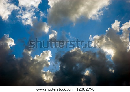 black and white clouds over deep blue
