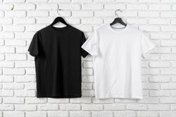 Black and white color two plain t-shirts, copy space