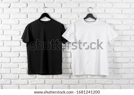 Black and white color two plain t-shirts, copy space Stock photo ©