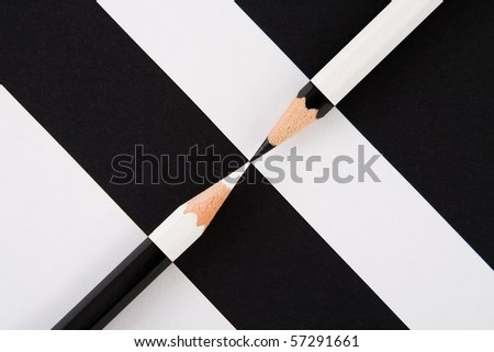 black and white composition of pencils and bands