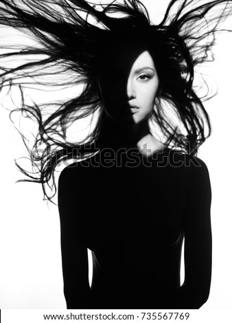 Black and white concept fashion photo of nude elegant woman wearing shadow. Fashion, Health and beauty