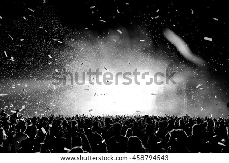 Black and White Confetti Silhouette Crowd at a Music Festival - Backlit.  #458794543