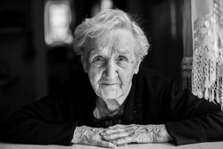 Black and white contrast portrait of an elderly woman.