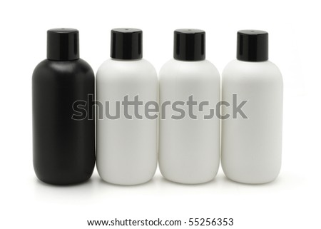 Black and white cosmetic containers on white background