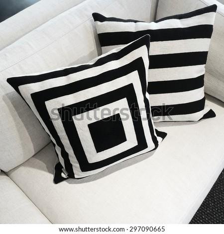 Black and white cushions on a sofa. Modern furniture.