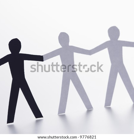 People Holding Hands Paper Cut Out. paper people holding hands