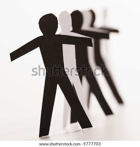 stock photo : Black and white cutout paper people standing in line together.