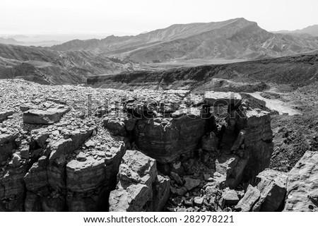 Black and white desert mountains cliffs. Rock canyons, Shhoret mountain, Negev desert, Israel.