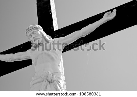 Black and white detail of crucifixion statue