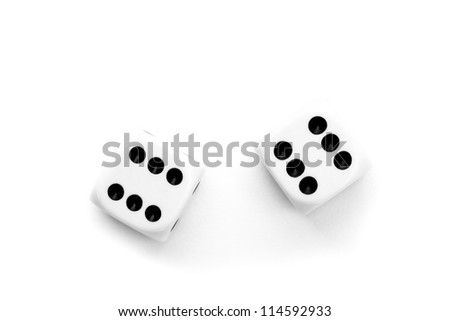Black and white dices against a white background