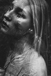 Black and white double exposure of young woman