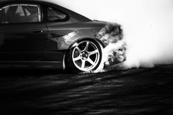 Black and white drifting car, Car wheel drifting and smoking on track.