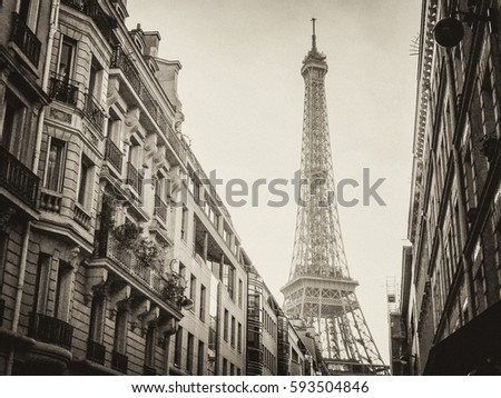 Black and White Eiffel Tower Between Buildings in Paris