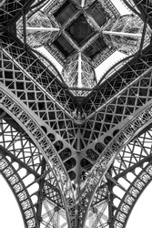 Black and white Eiffel Tower taken from underneath