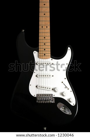 stock photo : Black and white electric guitar on a black background,